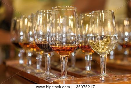 Tasting red and white wine. A tray with glasses. Close-up