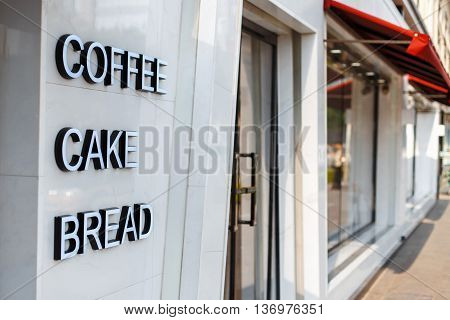 Restaurant cafe with door and window. Caption letters coffee cake bread
