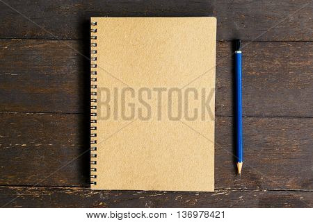 Brown Book And Pencil On Wood Table Background With Space