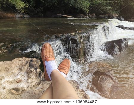 Legs From Sit View And Looking Waterfall