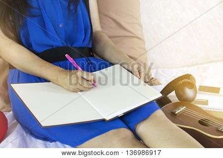 Hand With Pen, Writing Down On Blank Work Book Or Diary