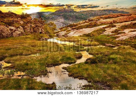 Sunset over mountains in the summer in Norway.