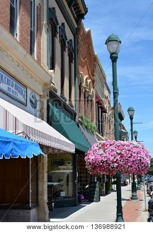 Winterset, Iowa-July 1st, 2016: View of the storefronts of downtown Winterset, Iowa.