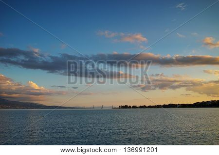 Amazing Sunset over The cable bridge between Rio and Antirrio view from Nafpaktos, Patra, Western Greece