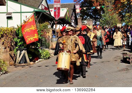 Mount Hope Pennsylvania - October 17 2015: The Royal Procession lead by a drummer heads to the village square at the annual Pennsylvania Renaissance Faire