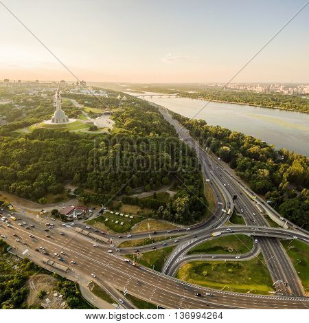 Panoramic view of the city of Kiev in the sunset from the bridge Paton. Mother Land and Park of Glory view. Aerial view, from above. Outdoor.