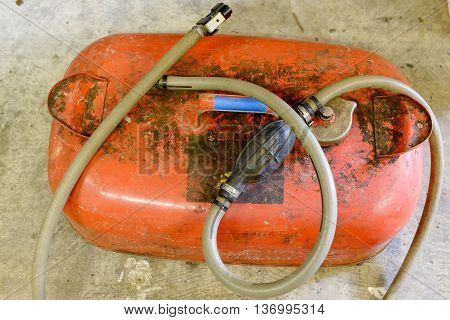 a red gasoline tank for motor boat