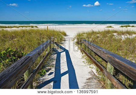 Wooden Beach Boardwalk leading to the white sandy Beach on Anna Maria Island