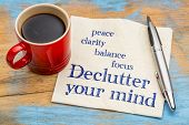Declutter your mind for clarity, peace, focus and balance - handwriting on a napkin with a cup of espresso coffee poster