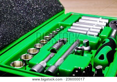 A Set Of Tools In A Green Box Close-up.