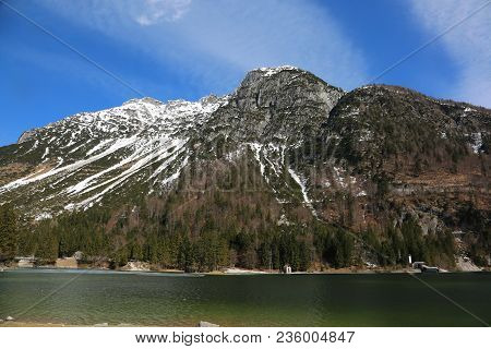 Little Lake Called Predil Lago In Italian Language And The Mountain With Snow