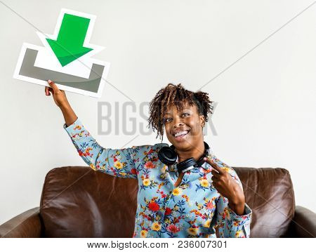 African American woman holding a download sign music and download concept