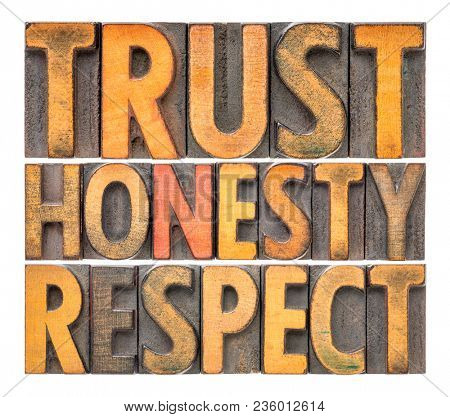 trust, honesty, respect - isolated word abstract in vintage letterpress wood type blocks tained by color inks