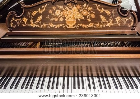 Keyboard Of A Luxurious Modern Expensive Grand Piano With An Open Lid Inlaid With Valuable Wood Spec