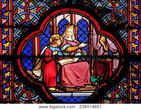 PARIS, FRANCE - JANUARY 05: Education of Saint Louis by Blanche de Castille, stained glass window in the Basilica of Saint Clotilde in Paris, France on January 05, 2018.