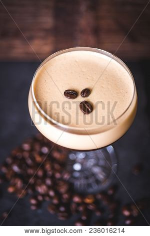 Top View Of The Coffee Beans Lying On The Foam Cocktail. Coffee Beans Lie On The Table Near The Wine