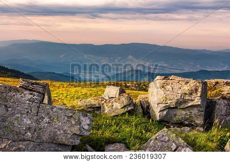 Sunset Light On Hills With Stones. Beautiful Mountainous Landscape On A Cloudy Day
