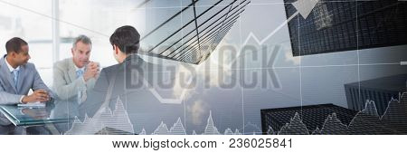 Business meeting by window with city finance graph transition