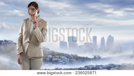 businesswoman with magnifying glass in cityscape