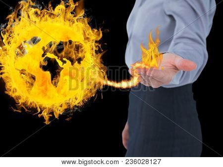 woman with hand spread of with earth fire icon coming up from it. Black background