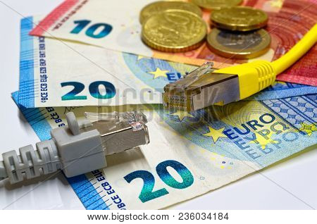 Two Ethernet Connection Plugs Lying On The Euro Banknotes