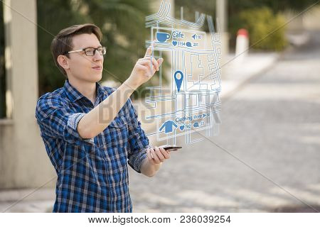 Augmented Reality In Marketing. Man Traveler With Phone. Navigation On The Projection Of The Display