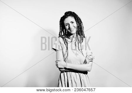 Studio Shoot Of Girl In Gray Dress With Dreads On White Background.