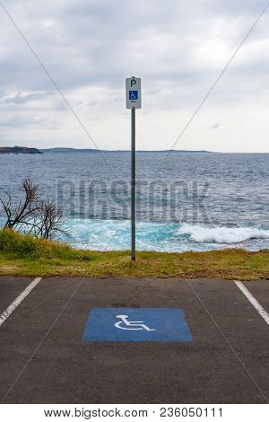 Special Parking Place Spot And Marking Sign For Disabled People Near Seaside In Australia