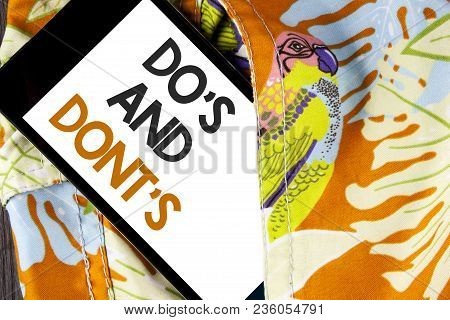 Conceptual Hand Writing Showing Do's And Don'ts. Business Photo Text What Can Be Done And What Canno