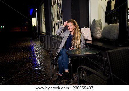 Girl With Dreadlocks Walking At Night Street Of City.