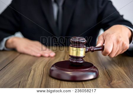 Male Lawyer Or Judge Hand's Striking The Gavel On Sounding Block, Working At Courtroom, Law And Just