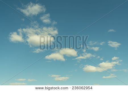 Blue Spring Sky With White Cumulus Clouds