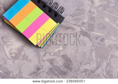 Notebook With Spiral And Blank Rectangle Colored Pages On Old Concrete Gray Cement With Copy Space
