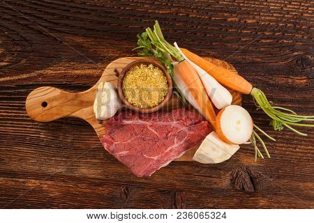 Fresh Vegetables And Steak Meat From Above On Wooden Table.