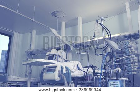 Hospital Room Interior With Sophisticated Electronic Installations And Patient Bed.