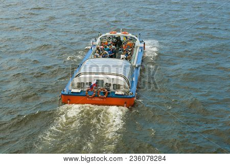 Saint Petersburg, Russia - July 30, 2017: The Boat With Tourists In The Water Area Of Neva Close Up.