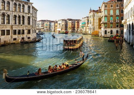 Venice, Italy - June, 21, 2013: View From Ponte Di Rialto To Grand Canal, Many Tourists People Enjoy