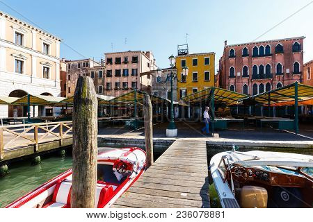 Venice, Italy - June, 21, 2013: A Man Follow Past Empty Openair Seafood Market Rows In Venice. Merca