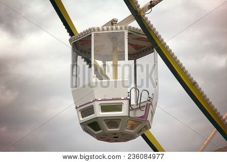 Entertainment Industry. Sunday Holiday Rides. Ferris Wheel, Big Wheel Metal Construction