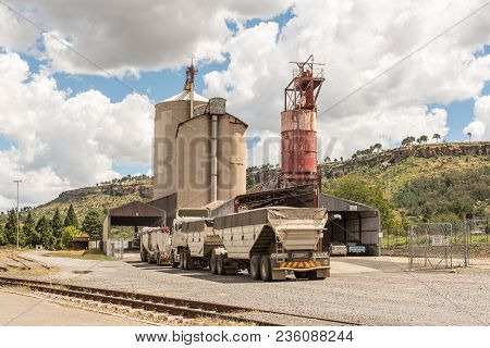 Ficksburg, South Africa - March 12, 2018: Trucks Waiting To Offload The Harvest At Silos In Ficksbur