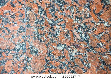 Natural Pattern Of Polished Red-gray Granite Facing Plate. Luxury Interior Decoration Is An Essentia