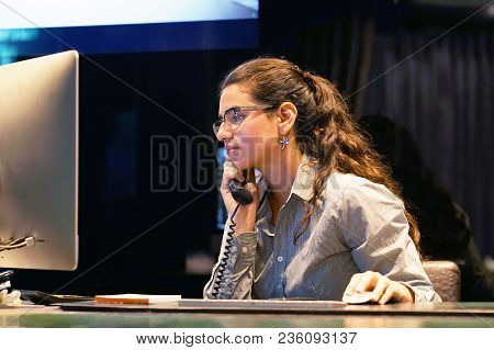 Close-up Of An Office Worker. Woman Secretary Answering Phone Calls And Talking With Customers, She