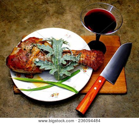 Delicious Turkey Leg On The Table With A Glass Of Red Wine,this Is What You Need Any Gourmet