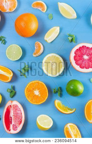 Natural Citrus Food Pattern On Blue Background - Assorted Citrus Fruits With Mint Leaves