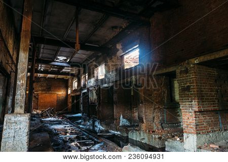Ruins Of Abandoned Industrial Warehouse, Dark Creepy Corridor Of Manufacturing Factory Workshop With