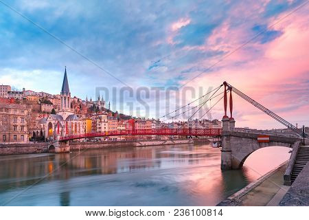Saint Georges Church And Footbridge Across Saone River, Old Town With Fourviere Cathedral At Gorgeou