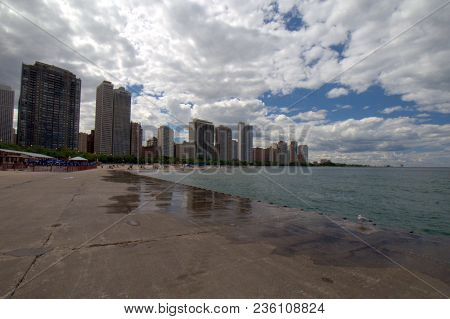 Oak Street Beach With The Gold Coast Of Chicago Condo And Apartment High Rise Buildings In The Backg