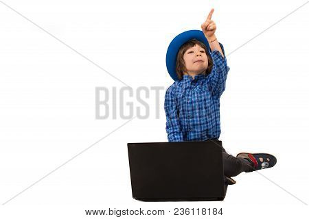Little Elegant Boy With Laptop Pointing Away Isolated On White Background