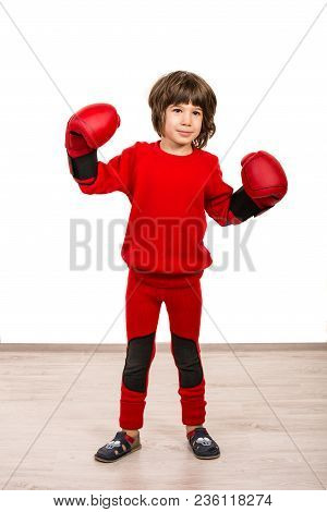 Cute Boy  With Boxing Gloves Showing His Fists