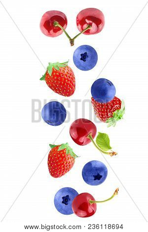 Isolated Falling Fruits. Falling Cherries, Strawberry And Blueberry Isolated On White Background Wit